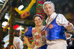 Couple wearing costumes at the parade of popular marches Marchas Populares in the Saint Anthony Feast at the Liberdade Avenue A Stock Photos