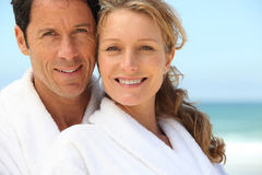 Couple wearing dressing gowns Stock Images