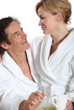 Couple wearing dressing gowns Royalty Free Stock Photo