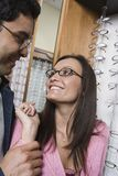 Couple Wearing Eye Glasses And Looking At Each Other Stock Photography