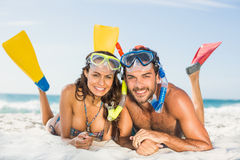 Couple wearing flippers at the beach Stock Photography