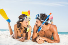 Couple wearing flippers at the beach Stock Photo