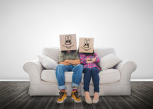 Couple wearing funny boxes on their head Stock Photos