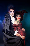 Couple wearing halloween costumes Stock Images
