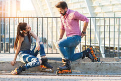 Couple wearing rollerblades. Stock Photo