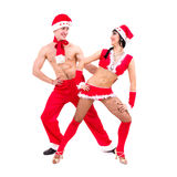 Couple wearing santa claus clothes dancing Stock Photography