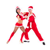 Couple wearing santa claus clothes dancing Royalty Free Stock Photography