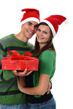 Couple wearing Santa hats isolated on white Royalty Free Stock Photography