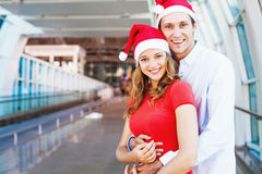 A couple wearing santa's hats royalty free stock images