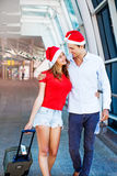 A couple wearing santa's hats stock images