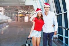 A couple wearing santa's hats Royalty Free Stock Image