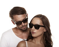 Couple wearing sunglasses isolated Stock Photography