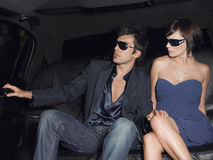 Couple Wearing Sunglasses In Limousine Royalty Free Stock Photography
