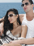 Couple Wearing Sunglasses On Yacht Stock Photography