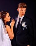 Couple wearing wedding dress and costume Stock Image