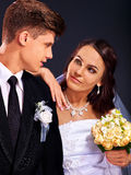 Couple wearing wedding dress and costume Royalty Free Stock Photos