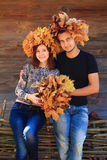 Couple wearing yellow acorn leaves crowns Stock Photos