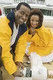Couple wearing yellow anoraks on yacht Royalty Free Stock Photography
