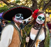 SAN ANTONIO, TEXAS - OCTOBER 28, 2017 - Couple wears costumes and sugar skull painted faces for Dia de los Muertos/Day of the Dead royalty free stock image