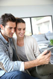 Couple websurfing on tablet Stock Photography