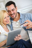Couple websurfing with tablet Royalty Free Stock Image