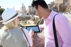 Couple websurfing on tablet during travel of Rome Stock Images