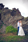 The couple in wedding attire in the mountains Royalty Free Stock Photos