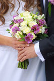 Couple with wedding bouquet Royalty Free Stock Image