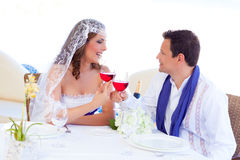 Couple in wedding day cheering with red wine Stock Image