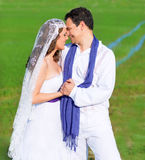 Couple in wedding day hug in green meadow stock photos