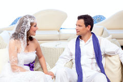 Couple in wedding day relaxed in white terrace Royalty Free Stock Photography