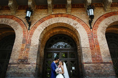 Couple in the wedding day under arch Stock Photo