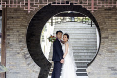 Couple wedding photo portrait shot in shui bo park of Shanghai Stock Photography