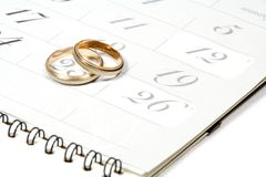 Couple of Wedding Rings on Calender. Symbolizing wedding date or anniversary Stock Photos
