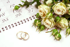 Couple of Wedding Rings on Calender Stock Photography