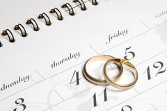 Couple of Wedding Rings on Calender. Symbolizing wedding date or anniversary Stock Image