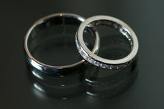 Couple of wedding rings on grey background Royalty Free Stock Images
