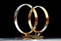 Couple wedding rings on top of car Royalty Free Stock Image