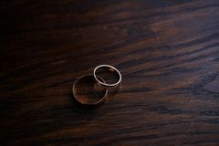 Couple of wedding rings on wooden table royalty free stock photo