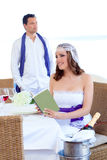 Couple in wedding woman reading book on banquet Stock Photo