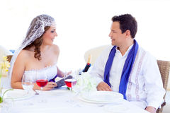 Couple in wedding woman reading book on banquet Royalty Free Stock Image