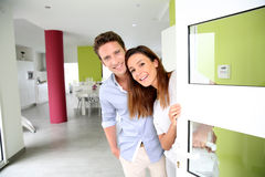 Couple welcoming people at home Royalty Free Stock Image