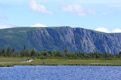 Couple on Western Brook Pond Trail. A couple walks on a boardwalk at Western Brook Pond in Gros Morne National Park, Newfoundland, Canada Stock Photography