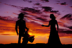 Couple western in sunset Royalty Free Stock Photo