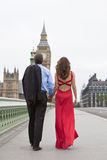 Couple on Westminster Bridge Big Ben London Englan. Rear view of romantic men and women couple on Westminster Bridge with Big Ben in the background, London Royalty Free Stock Photo