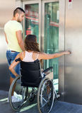 Couple with wheelchair in elevator Royalty Free Stock Images