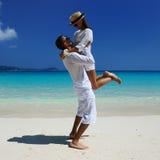 Couple in white on a beach Stock Photos