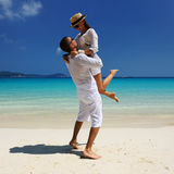 Couple in white on a beach Royalty Free Stock Images