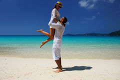 Couple in white on a beach Royalty Free Stock Image