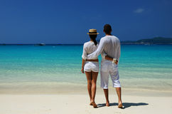 Couple in white on a beach Stock Photography